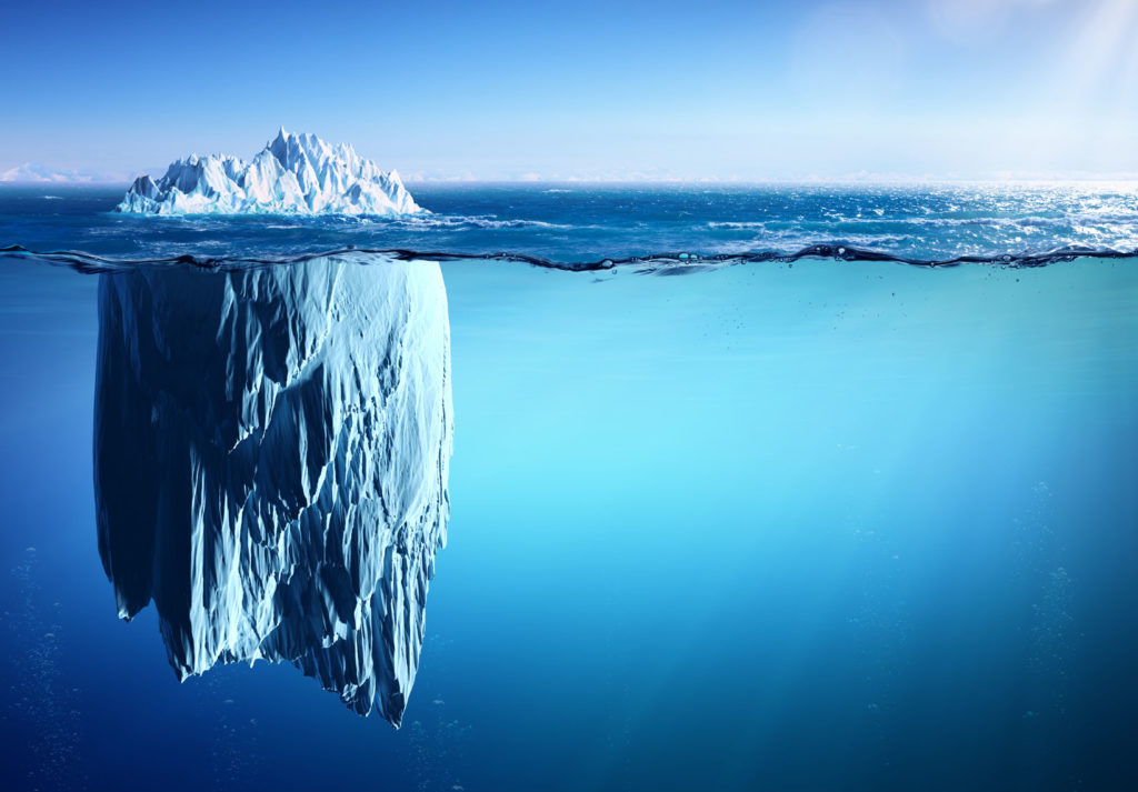 iceberg floating on sea